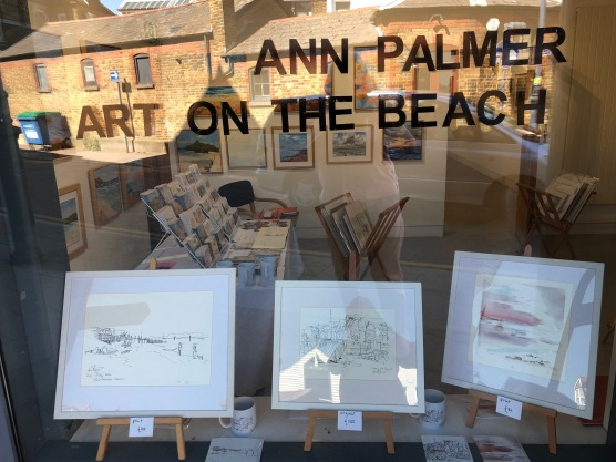 Ann Palmer Horsebridge Arts Centre Solo Exhibition 1-14 August Art on the Beach window showing prints and paintings